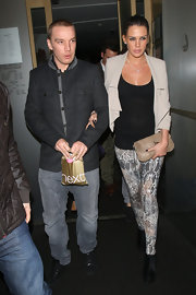 Danielle Lloyd paired her snakeskin print leggings with a versatile nude leather clutch.