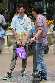Sam Pepper chose a tropical-print top to show off his quirky style.