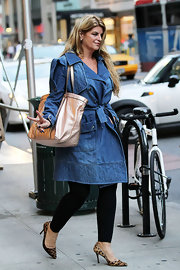 Kirstie Alley accessorized her denim coat with a metallic gold shopper bag as she headed to a salon in New York City.