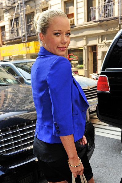 Kendra opted for a sleek twisted bun with a chic, business ensemble.