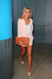 Mollie King accessorized her fresh look with bow detailed peep-toe pumps.