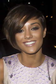 Frankie Sandford emphasized her big brown eyes with a shimmery gold shadow and elongated cateyes.