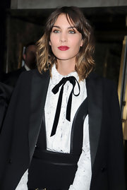 Alexa wears a dark red dramatic lipstick with this black and white outfit.