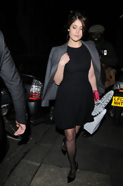 Gemma Arteton sported a gray blazer as a cape for a trendy addition to her evening look.