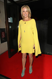 Amanda Holden went all-out with color, pairing intricate strappy turquoise heels with her yellow dress.