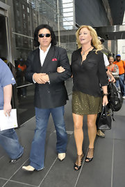 Shannon Tweed paired a loose top with a green studded skirt.