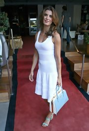 Elisabetta Canalis paired her sexy-meets-sweet white knit dress with baby blue heels.