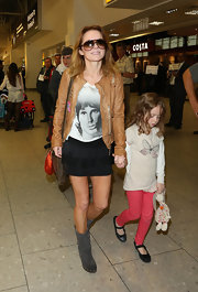 Geri's black mini skirt added a touch of feminine flare to her travel look.