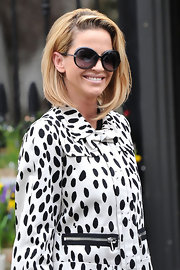 Sarah Harding looked 1960s chic wearing large round sunglasses and a mid-length asymmetrical bob with loads of body while out in London.