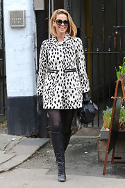 Sarah Harding showed her spots in a playful Dalmatian print coat.
