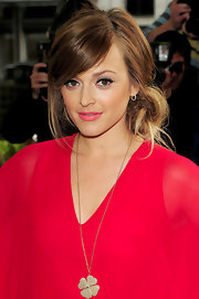 Fearne showed a softer side in a side swept bun. She kept her look natural with loose pieces and a low bun.