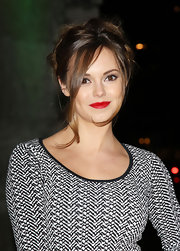 Hannah gave her black and white look a little pop of color with red lipstick.