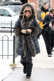 Goldie Hawn took a more is more approach to furry attire in black furry knee high boots.