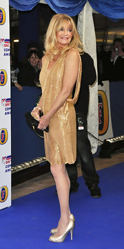 Goldie Hawn lit up the blue carpet at the 2011 British Comedy Awards in champagne satin platform pumps.