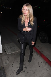 Nicky Hilton arrived at the Chateau Marmont wearing a pair of strappy black motorcyle boots.