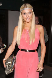 Paris Hilton went out for dinner in Beverly Hills wearing her long tresses with a center part and sparkly headband.