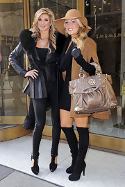 Gretchen Rossi carried a metallic taupe tote around NYC.