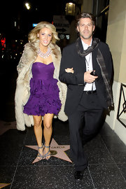 Gretchen dons a purple ruffled cocktail dress under a lux fur coat while out in LA.