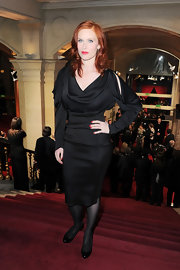 Audrey Fleurot exuded old-world glamour in a cutout LBD with a cowl neck and draped sleeves.