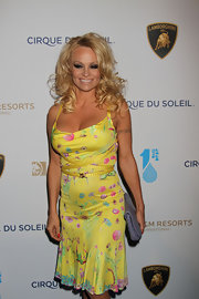 Pamela Anderson chose a bright yellow, floral dress for her look Springy look at the 'One Night for One Drop' event in Las Vegas.