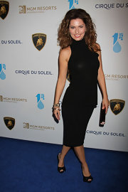 Shania Twain chose a classic, sleek LBD for her sophisticated look at the 'One Night for One Drop' event in Las Vegas.