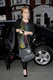 Adele carried a gray leather messenger bag with a chain strap for the Beyonce show.