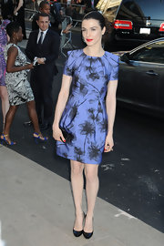 Rachel looked chic in a Resort 2011 printed custom cocktail dress with black pumps and bright red lipstick.