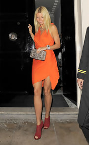 Gwyneth accessorized her look with a patent python clutch.