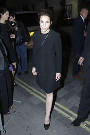 Noomi Rapace complemented her dress with an equally classic pair of studded platform pumps.