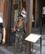 Beyonce's printed jumpsuit kept her look casual but chic while out with her daughter and husband.