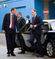 Prince William makes a trip to the Royal Festival Hall in a pair of his signature black patent oxfords.