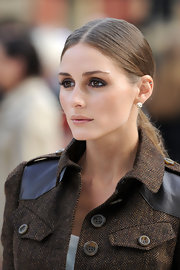 A center-parted ponytail gave Olivia a sleek appearance at the Burberry Spring 2013 runway show in London.