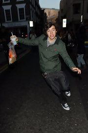 Harry Styles wears a pair of blue canvas Chuck Taylors.