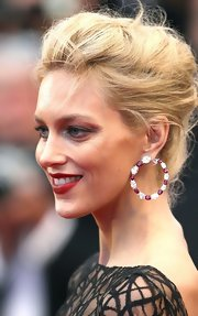 Anja Rubik looked totally glam at the 'Cosmopolis' premiere with her diamond and ruby hoops and elegant updo.