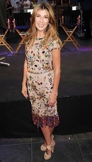 Nina Garcia charmed at the 'Project Runway' 10th anniversary kickoff in a nude dress with colorful beading.