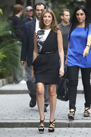 Nina Garcia dazzled on the 'Project Runway' set in a pair of strappy black suede platform sandals.