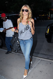 Heidi opted for a basic gray athletic tank and jeans for her look while out and about in NYC.