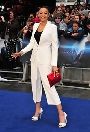 Amal Fashanu rocked a crisp white menswear-inspired suit at the 'Man of Steel' premiere in London.