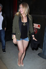 Hilary Duff dressed up a pair of denim shorts with this forest green blazer.