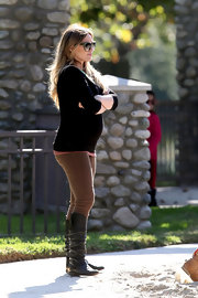Hilary Duff was chic while out and about town. Hilary opted for ruched black leather knee-high boots.