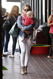 Hilary Duff rocked white skinny pants on a casual lunch with baby son Luca.