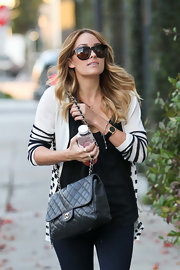 Lauren Conrad added instant glamor to her classic street style with a pair of tortoiseshell cateyes.