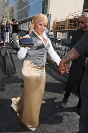 Lil Kim carried a leather coated box clutch at fashion week.