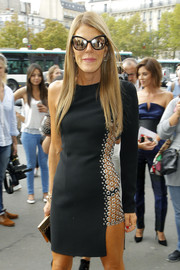 Anna dello Russo complemented her sexy LBD with mirrored Chanel cateye sunnies for total fierceness at the Rochas fashion show.