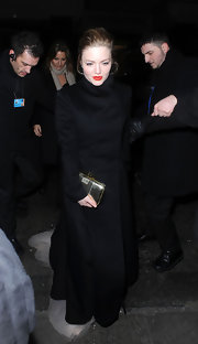 Holliday Grainger arrived at the BAFTA after-party wearing a black overcoat.
