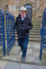 John C. Reilly sported a cool navy pea coat while walking the streets of Glasgow.