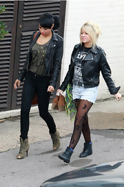 Sophia showed off her edgy side in a studded leather jacket and lace printed tights.