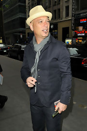 Wearing a charcoal blazer and a gray scarf, Howie Mandel looked stylish in a laid-back way.