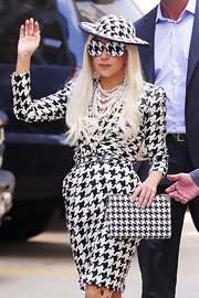 Lady Gaga completed her houndstooth ensemble with a patterned clutch from the same collection. Heavy pearls and opaque houndstooth shades completed her look.