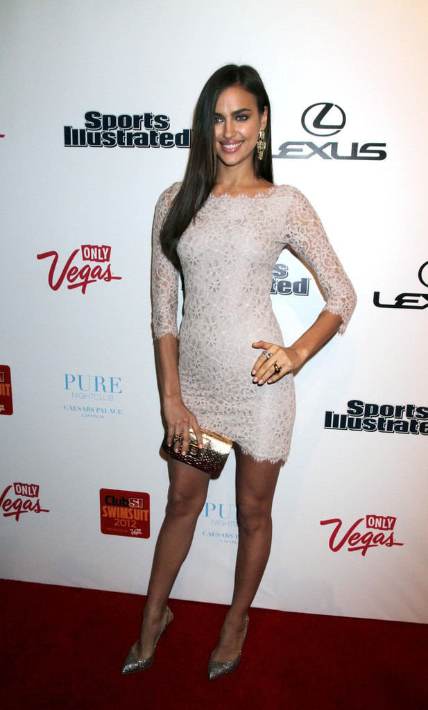 b9d60040754 Irina showed her classy side in this sweet lace cocktail dress at the   Sports Illustrated